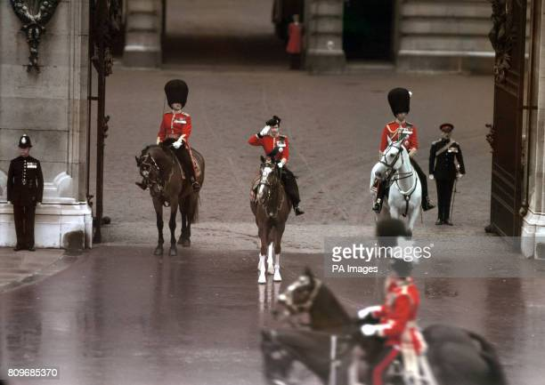 The march past at Buckingham Palace with Queen Elizabeth II riding police horse Imp taking the salute at the gate after the Trooping the Colour...