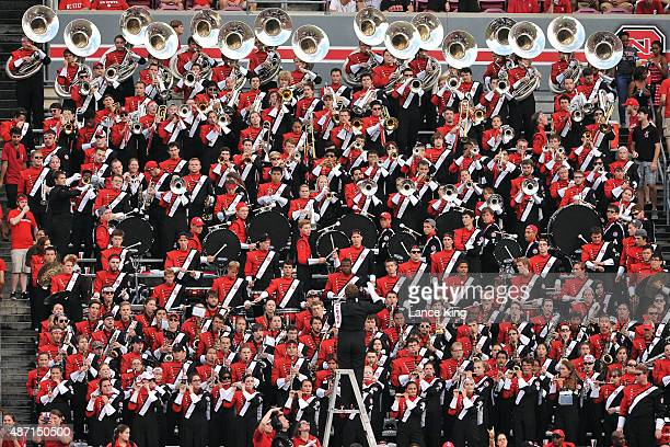 The marching band of the North Carolina State Wolfpack performs during their game against the Troy Trojans at CarterFinley Stadium on September 5...