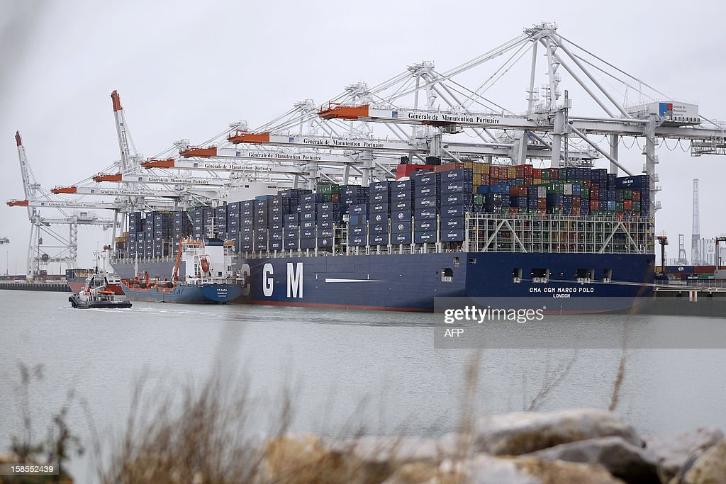 The Marco Polo, flying a British flag and said to be the world's biggest container ship by French owners CMA CGM, is moored in the port of Le Havre, western France, early on December 19, 2012. The Marco Polo was given its champagne christening in the Belgian port of Zeebrugge on December 18, 2012. The ship, which is 396 metres (yards) long -- the length of four football fields -- was built in South Korea and was to head back to Asia after a stop in France. It is said to be the largest container in the world measured by capacity, as it can hold 16,020 TEU (twenty-foot equivalent unit containers) -- or 97 kilometres of containers lined up one by one.