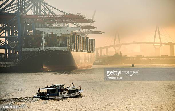 The Marco Polo the world's biggest container ship docks at a container terminal Burchardkai on December 12 2012 in the harbour of Hamburg Germany The...