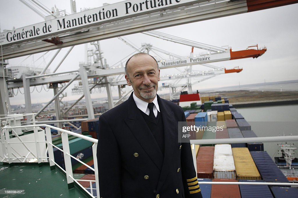 The Marco Polo's captain Igor Sikic poses on the deck of the Marco Polo, flying a British flag and said to be the world's biggest container ship by French owners CMA CGM, moored in the port of Le Havre, western France, early on December 19, 2012. The Marco Polo was given its champagne christening in the Belgian port of Zeebrugge on December 18, 2012. The ship, which is 396 metres (yards) long -- the length of four football fields -- was built in South Korea and was to head back to Asia after a stop in France. It is said to be the largest container in the world measured by capacity, as it can hold 16,020 TEU (twenty-foot equivalent unit containers) -- or 97 kilometres of containers lined up one by one.