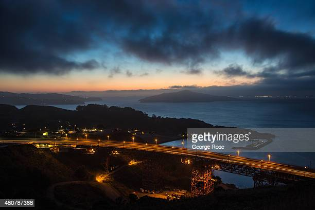 The Marin side of the Golden Gate Bridge is viewed from the Marin Headlands just before sunrise on June 23 in San Francisco California San Francisco...