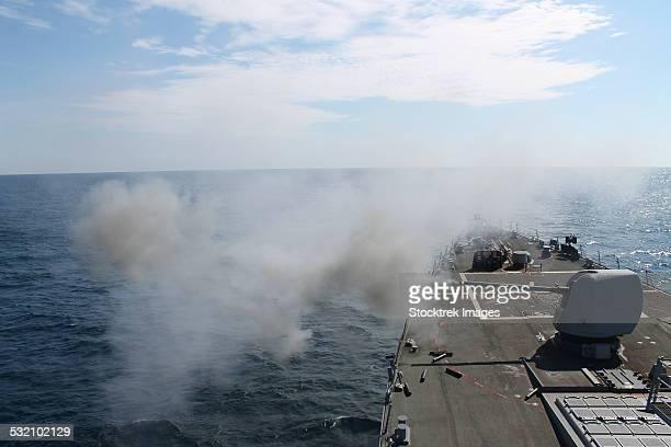 The Mark 45 lightweight gun is fired aboard USS Mahan.