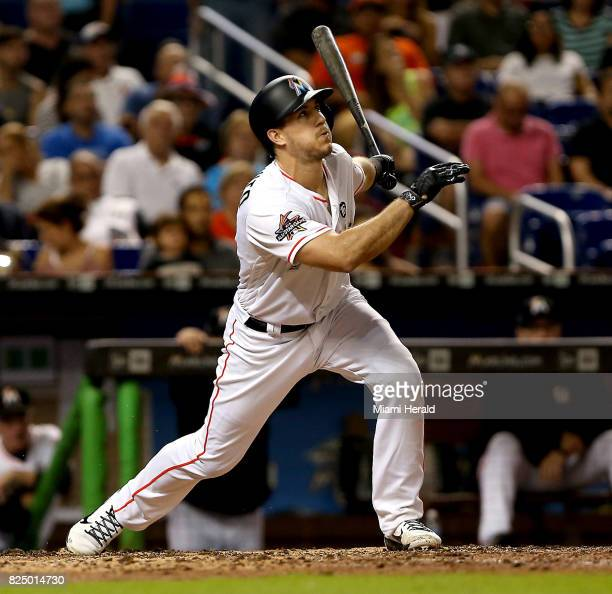The Marlins' JT Realmuto swings at a pitch in the fifth inning as the Miami Marlins host the Washington Nationals Monday July 31 2017 at Marlins Park...