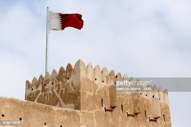 The maroon and white national flag of Qatar flying at the Al Zubarah Fort a UNESCO World Heritage Site in Madinat ash Shamal Qatar The country of...