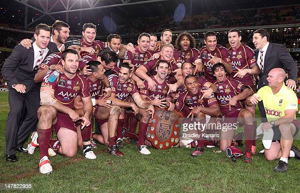 The Maroons celebrate victory after game three of the 2012 State of Origin series between the Queensland Maroons and the New South Wales Blues at...