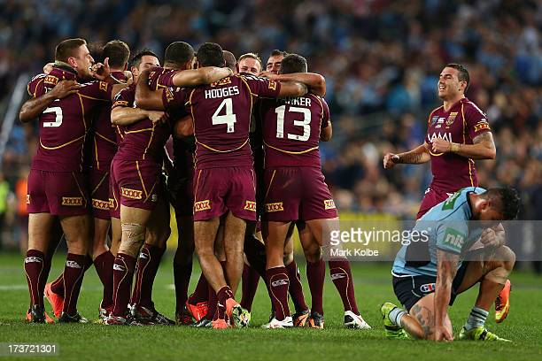 The Maroons celebrate winning game three of the ARL State of Origin series between the New South Wales Blues and the Queensland Maroons at ANZ...