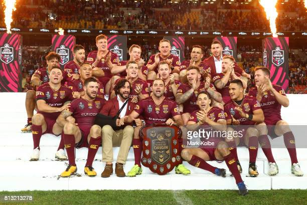 The Maroons celebrate winning game three of the State Of Origin series between the Queensland Maroons and the New South Wales Blues at Suncorp...