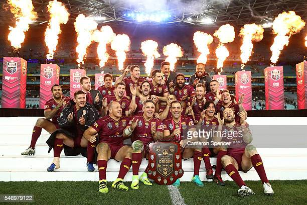 The Maroons celebrate with the State Of Origin trophy after winning the series 21 after game three of the State Of Origin series between the New...