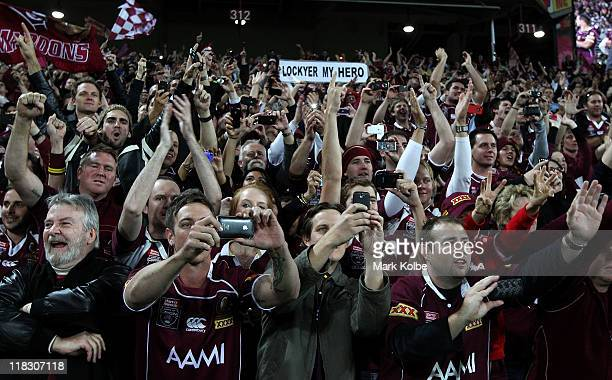 The Maroons crowd cheer their players on the victory lap during game three of the ARL State of Origin series between the Queensland Maroons and the...