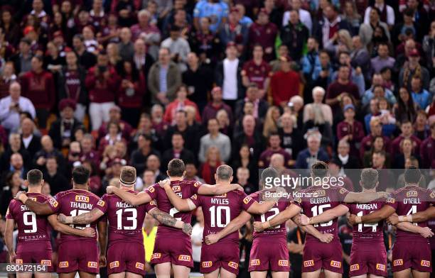 The Maroons embrace before game one of the State Of Origin series between the Queensland Maroons and the New South Wales Blues at Suncorp Stadium on...