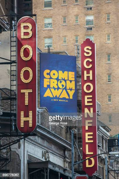 The marquee at the Booth Schoenfeld Theatre promotes the Broadway production of 'Come From Away' is viewed on June 10 2017 in New York New York With...