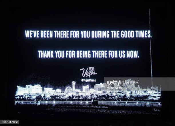 The marquee at the Treasure Island Hotel Casino displays a message of gratitude in response to Sunday night's mass shooting at a music festival on...