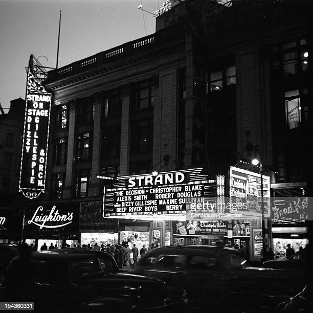 The marquee for the bill of the move 'The Decision of Christopher Blake' starring Alexis Smith and Robert Douglas with Dizzy Gillespie and his BeBop...