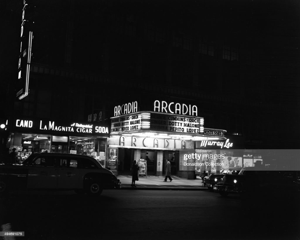 The marquee of the Arcadia Theater reads 'Bernie Cummins Orchestra, Singer Dotty Malone, Rhumbas Pepito Lopez' in May 1952 in New York.