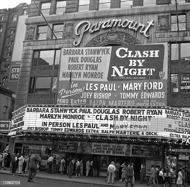 The marquee of the New York Paramount advertises the bill for the evening which featured the movie 'Clash By Night' with Barbara Stanwyck Paul...