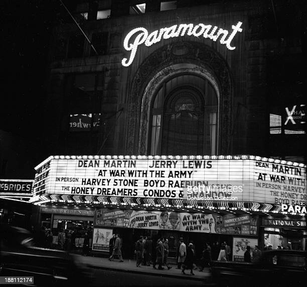 The Marquee of the New York Paramount Theatre on features Dean Martin Jerry Lewis in 'At War With The Army' and in person Harvey Stone Boyd Raeburn...