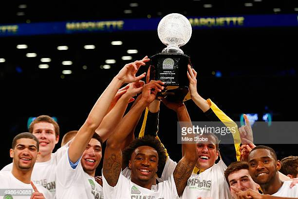 The Marquette Golden Eagles celebrates after defeating the Arizona State Sun Devils to win the 2015 Legends Classic at Barclays Center on November 24...