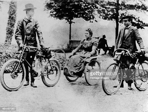 The Marquis Carcano and Carlo Maserati at Anzano del Parco 1898 Marquis Michele Carcano is holding the front of the tricycle in which a woman is...