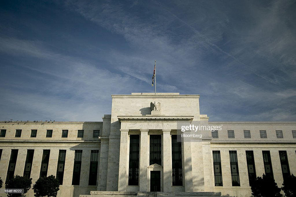 The Marriner S. Eccles Federal Reserve building stands in Washington, D.C., U.S., on Tuesday, Oct. 23, 2012. Federal Reserve Chairman Ben S. Bernanke, who is seeking to spur the economy with a third round of so-called quantitative easing, has said his stimulus works by lowering borrowing costs and encouraging investors to seek higher-yielding assets. Photographer: Andrew Harrer/Bloomberg via Getty Images
