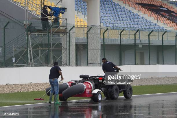 The marshall staff at work on track for clean the asphalth during the MotoGp of Qatar Qualifying at Losail Circuit on March 25 2017 in Doha Qatar