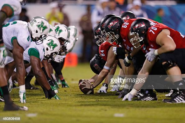 The Marshall Thundering Herd and Northern Illinois Huskies line up on the line of scrimmage during the first half of the game at FAU Stadium on...