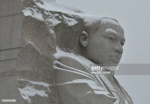 The Martin Luther King Junior Memorial is seen under snowfall on January 22 2016 in Washington DC The Washington region is under a blizzard with a...
