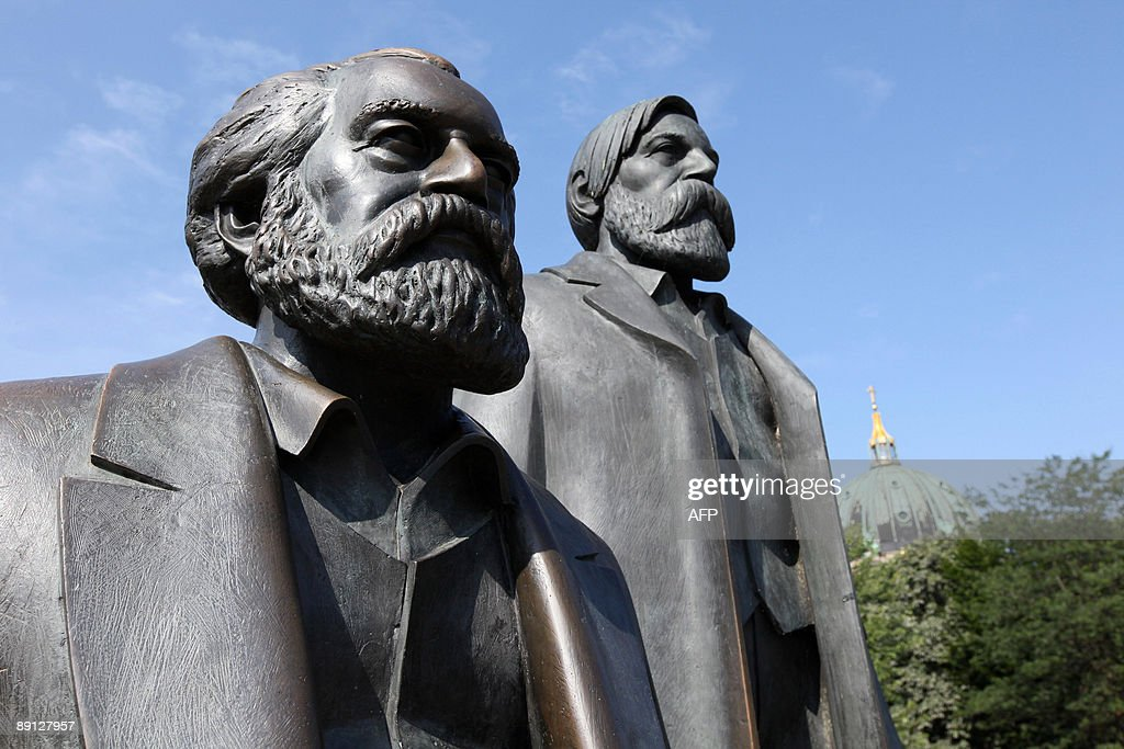 The Marx-Engels monument can be seen with Berlin's cathedral in the background on July 21, 2009. The statue of German philosophers Friedrich Engels (R) and Karl Marx is one of many tourist attractions in the German capital.