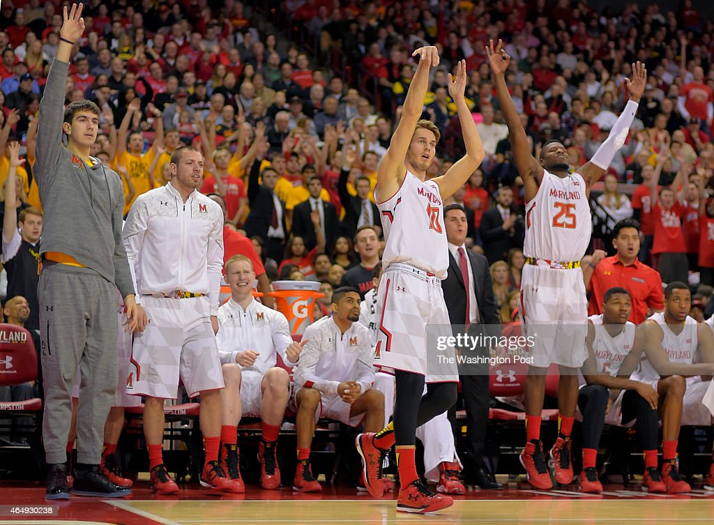 The maryland bench reacts as Maryland guard/forward Jake Layman (10), center right, hits a late 2nd half 3 point shot during the University of Maryland's defeat of Michigan 66 - 56 in mens basketball at College Park MD , February 28, 2015