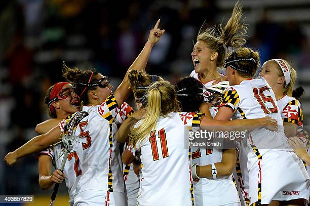 The Maryland Terrapins celebrate after defeating the Syracuse Orange in the NCAA Division I Women's Lacrosse Championship at Johnny Unitas Stadium on...