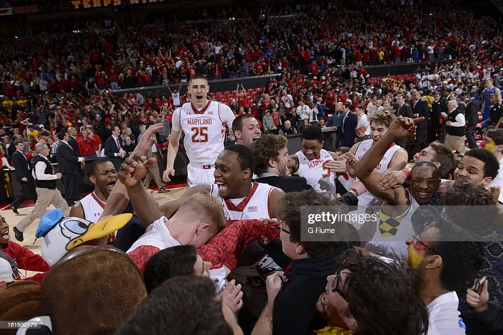 The Maryland Terrapins celebrate with fans after a 83-81 victory over the Duke Blue Devils at the Comcast Center on February 16, 2013 in College Park, Maryland.