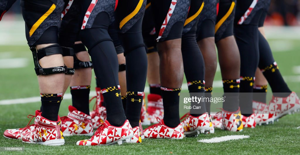 The Maryland Terrapins offense huddles against the Georgia Tech Yellow Jackets defense during the first half at Byrd Stadium on November 3, 2012 in College Park, Maryland.