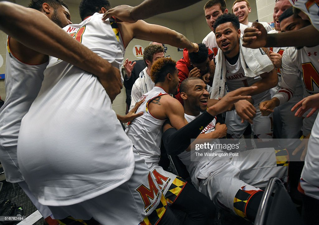 The Maryland Terrapins surround Maryland Terrapins guard Rasheed Sulaimon in the locker room after winning the NCAA Men's Basketball Tournament...