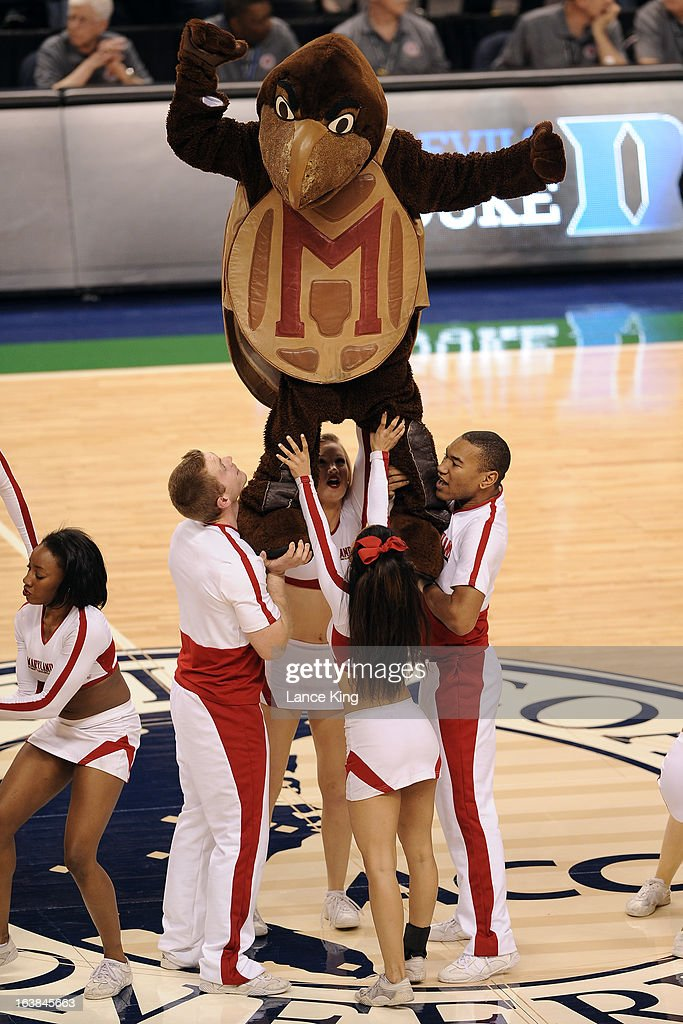 The mascot and cheerleaders of the Maryland Terrapins perform during a game against the Duke Blue Devils during the quarterfinals of the 2013 Men's ACC Tournament at the Greensboro Coliseum on March 15, 2013 in Greensboro, North Carolina. Maryland defeated Duke 83-74.