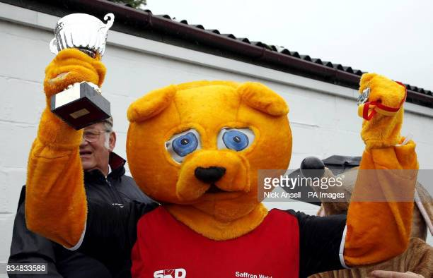 The mascot for Saffron Walden FC Wacky Macky Bear holds his trophy and medal after winning the 10th annual Mascot Grand National at Huntingdon...
