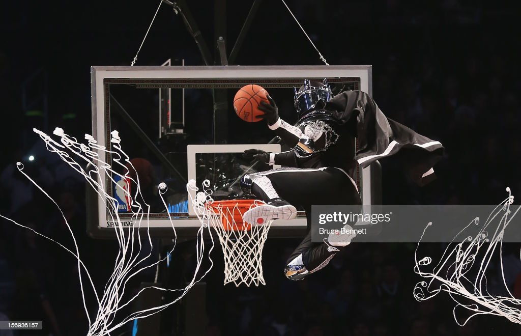 The mascot for the Brooklyn Nets, the BrooklyKnight flies in to score two during a break in the game between the Brooklyn Nets and the Los Angeles Clippers at the Barclays Center on November 23, 2012 in the Brooklyn borough of New York City.