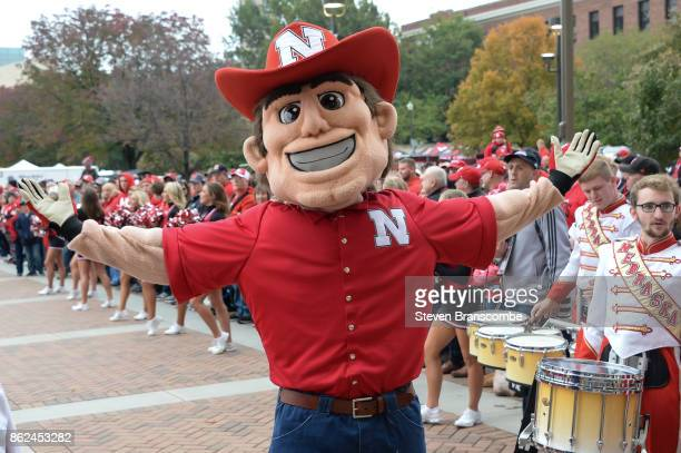 The mascot for the Nebraska Cornhuskers performs before the game against the Ohio State Buckeyes at Memorial Stadium on October 14 2017 in Lincoln...