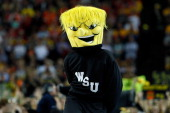 The mascot for the Wichita State Shockers performs against the Louisville Cardinals during the 2013 NCAA Men's Final Four Semifinal at the Georgia...