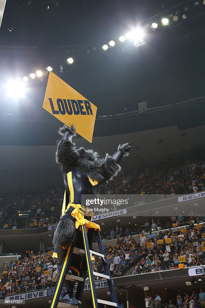 The mascot, Grizz holds up a sign to the fans during the game against the Oklahoma City Thunder in Game Four of the Western Conference Quarterfinals during the 2014 NBA Playoffs on April 26, 2014 at FedExForum in Memphis, Tennessee.