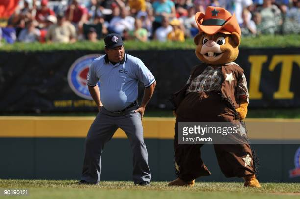 The mascot of little league world series Dugout dances with an umpire during a break during the game between California and Asia Pacific in the...