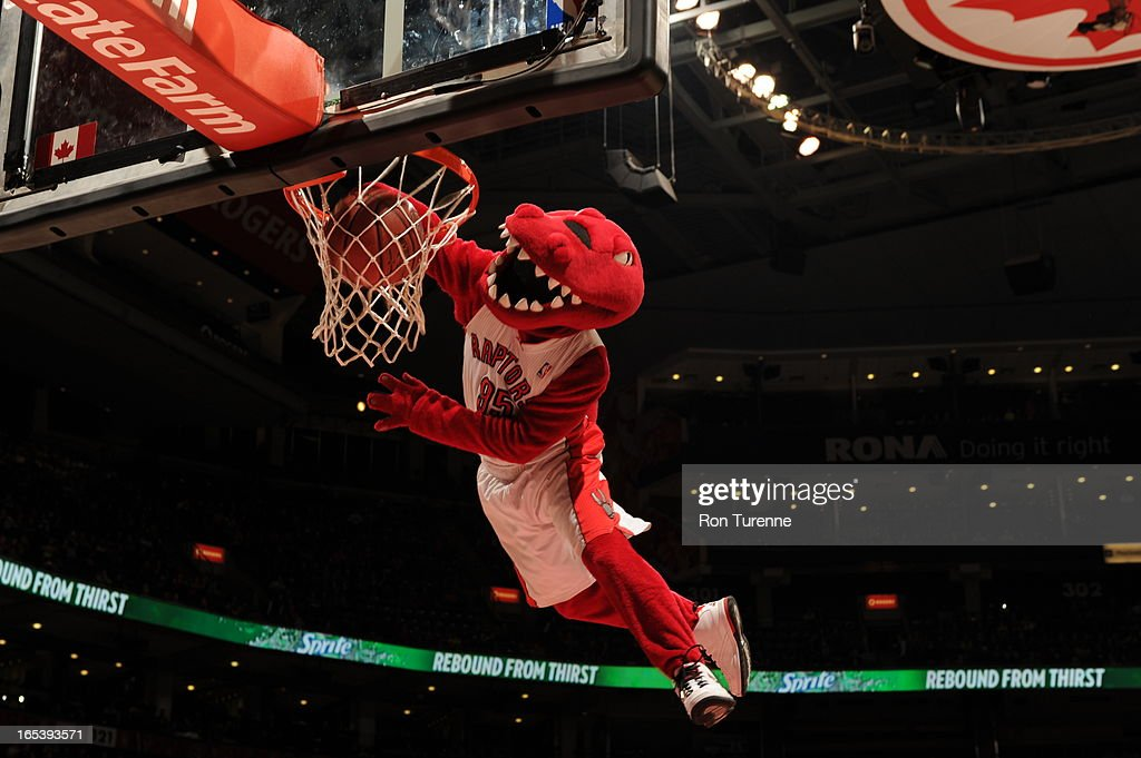 The mascot of the Toronto Raptors dunks the ball against the Washington Wizards during the game on April 3, 2013 at the Air Canada Centre in Toronto, Ontario, Canada.