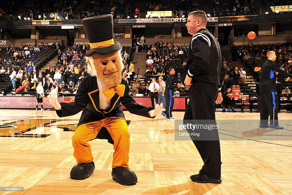 The mascot of the Wake Forest Demon Deacons dances in front of referee Tim Kelly prior to a game against the Duke Blue Devils at Lawrence Joel Coliseum on January 30, 2013 in Winston-Salem, North Carolina. Duke defeated Wake Forest 75-70.