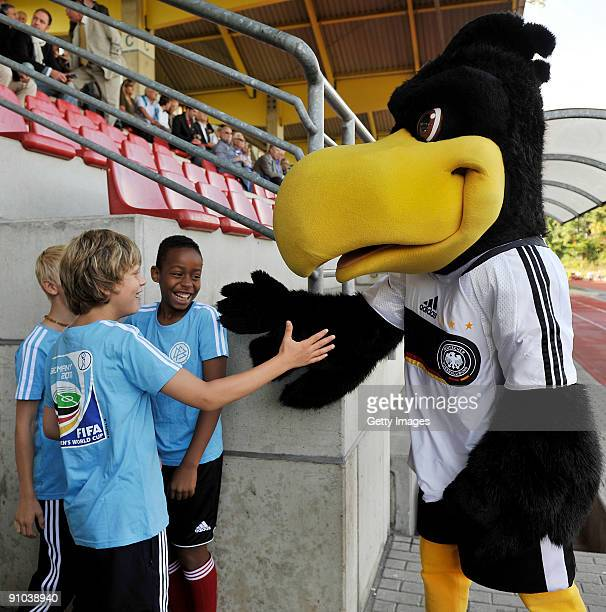 The mascot paule jokes to young boys prior to the U17 friendly international match between Germany and Israel at the Belkaw Arena on September 22...