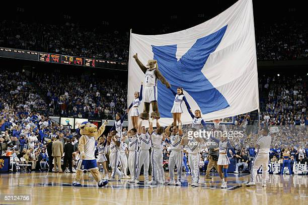 The mascots and cheerleaders of the Kentucky Wildcats build a pyramid during the game against the Kansas Jayhawks on January 9 2005 at Rupp Arena in...