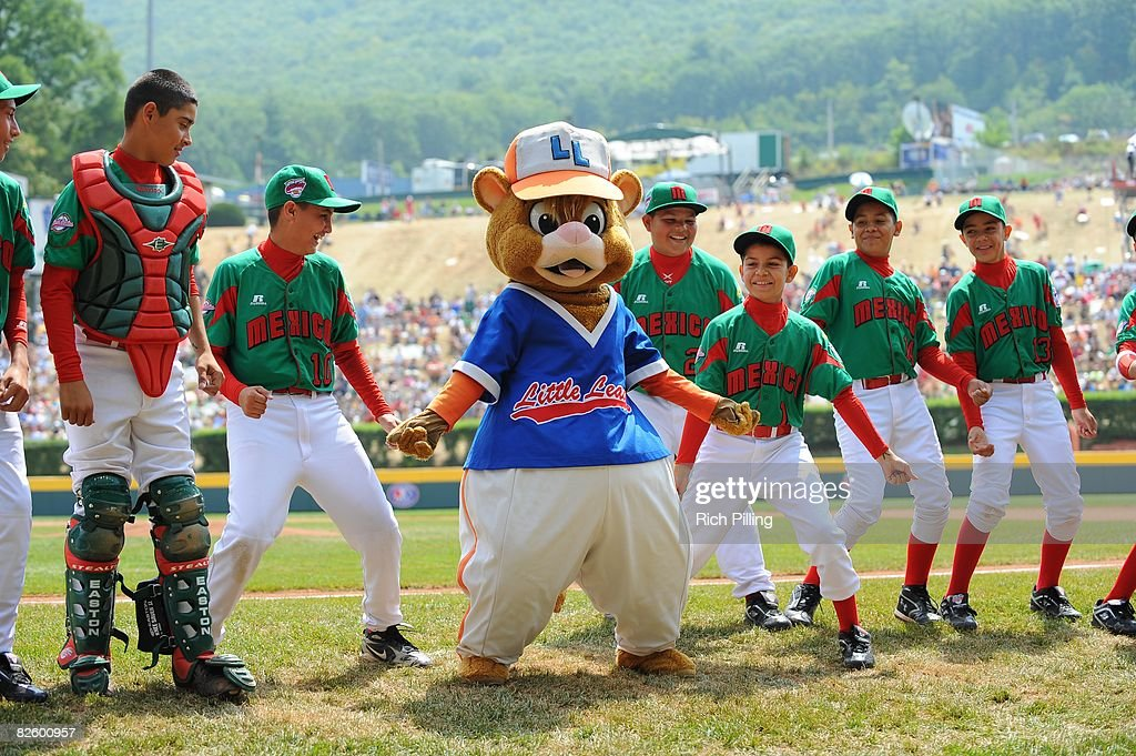 The mascots dance with the players before the game between the Waipio (West) Little League team from Waipio, Hawaii and the Matamoros Little League from Matamoros, Mexico team during the World Series Championship game at Lamade Stadium in Williamsport, PA on August 24, 2008. The Waipio team defeated the Matamoros team 12-3.