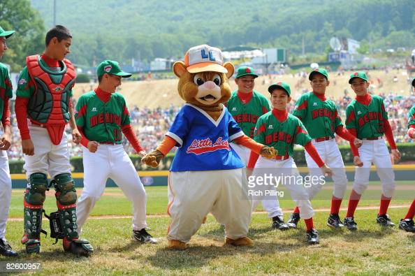 The mascots dance with the players before the game between the Waipio Little League team from Waipio Hawaii and the Matamoros Little League from...