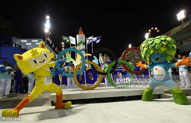 The mascots of the Rio 2016 Olympic Games Vinicius and of the Paralympic Games Tom perform during the opening ceremony on the first day of parades at...