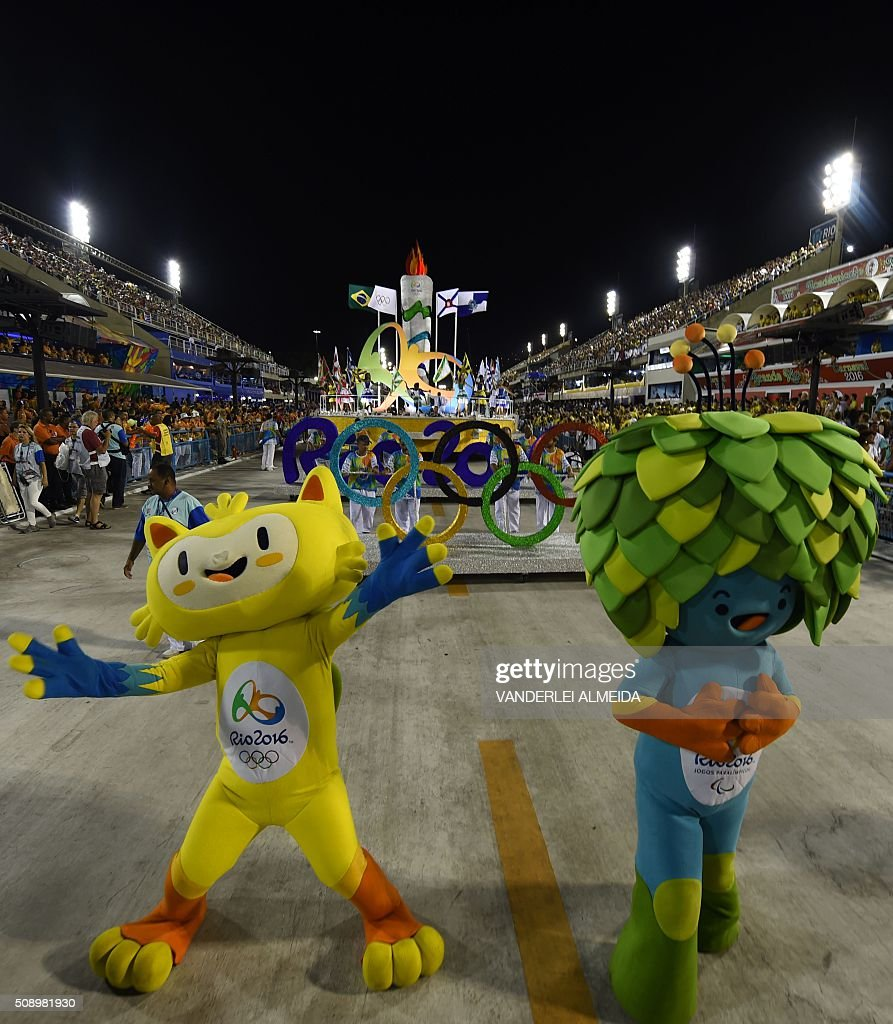 The mascots of the Rio 2016 Olympic Games, Vinicius (L), and of the Paralympic Games, Tom (R), perform during the opening ceremony on the first day of parades at the Sambadrome in Rio de Janeiro, Brazil on February 7, 2016. AFP PHOTO/ VANDERLEI ALMEIDA / AFP / VANDERLEI ALMEIDA