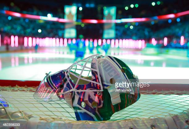 The mask of Eddie Lack of the Vancouver Canucks sits on the net during their NHL game against the New York Rangers at Rogers Arena April 1 2014 in...