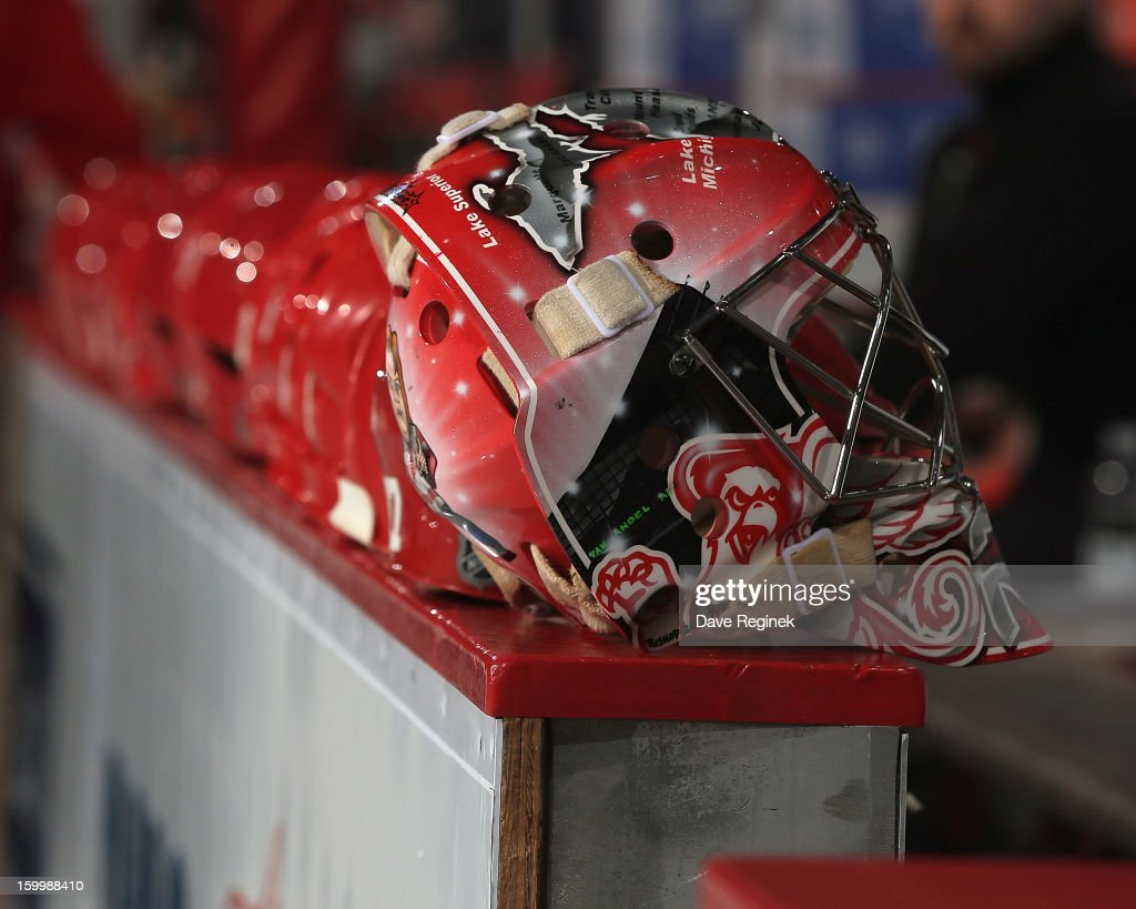 The mask of goaltender Tom McCollum #38 of the Detroit Red Wings sits on the dasher board during pre-game ceramonies before an NHL game against the Dallas Stars at Joe Louis Arena on January 22, 2013 in Detroit, Michigan. Dallas won 2-1